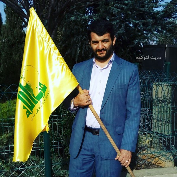 عکس حجت الله عبدالملکی در مورد ریزش بورس با عکس پرچم حزب الله
