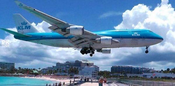عکس های ساحل خطرناک و توریستی کنار فرودگاه,ترسناک ترین ساحل دنیا,عکس های از ساحل ماهو در هلند کنار فرودگاه,عکس پرواز هواپیما در ده متری ساحل,ساحل توریستی